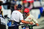 14-15 September, 2012, Fontana, California, USA.Rubens Barrichello (8) and Tony Kanaan (11) have a laugh atfer qualifying..(c)2012, Jamey Price.LAT Photo USA
