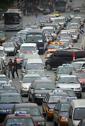 Bumper to bumper traffic at an intersection in central Beijing May 19 ,2006. Worldwide demand for oil will only increase as China and India emerge as economic powers.