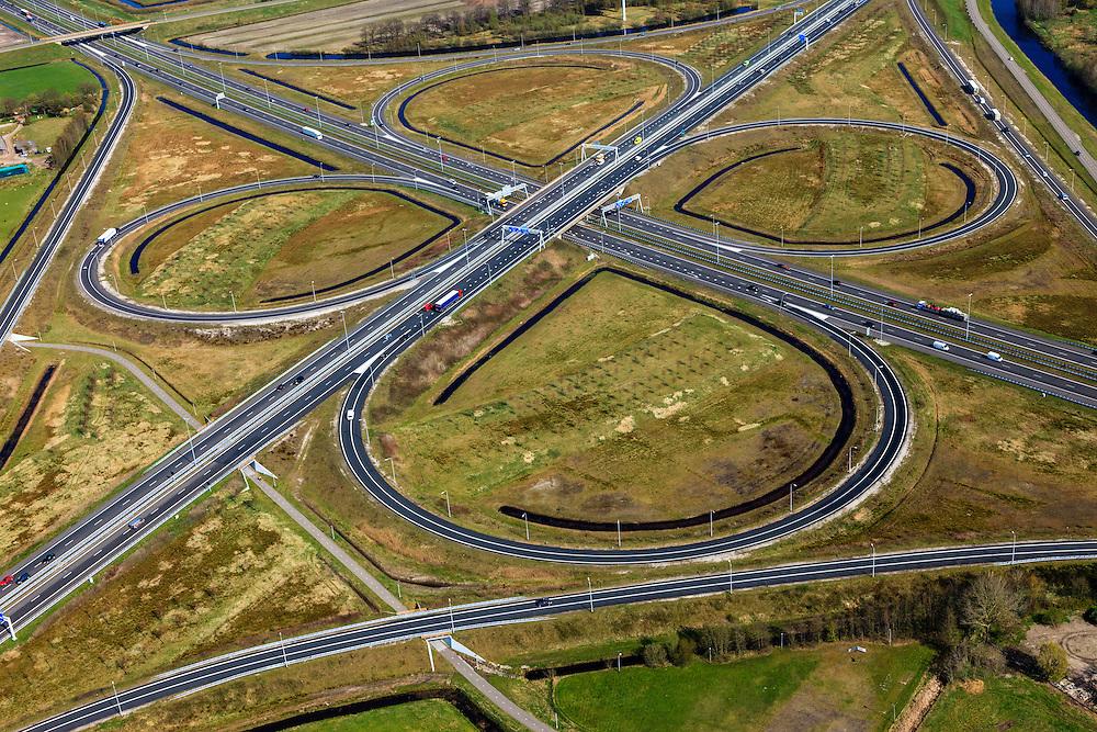 Nederland, Friesland, Gemeente Heerenveen, 01-05-2013; knooppunt Heerenveen, klaverblad. Kruising A32 naar Leeuwarden en Meppel / Zwolle, A7 naar Joure en naar Drachten / Groningen (linksboven).<br /> Junction Heerenveen (Friesland, Northern Netherlands, cloverleaf.<br />  luchtfoto (toeslag op standard tarieven)<br /> aerial photo (additional fee required)<br /> copyright foto/photo Siebe Swart