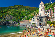 The Beach and clock tower at Vernazza, Cinque Terre, Liguria, Italy