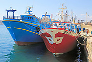 Two colourful trawler fishing boats in harbour  Grand  Harbour, Valletta, Malta