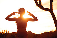 Sunset energy healing movement. Ecstatic dancer and Reiki healer woman.