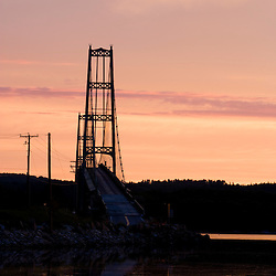 The Deer Isle bridge at sunrise in Little Deer Isle, Maine.