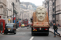 EDITORIAL USE ONLY<br /> Three 8 foot models of the heads of The Grand Tour presenters, Jeremy Clarkson, James May and Richard Hammond pass through Piccadilly in London on the back of flatbed trucks after travelling 30,000 miles across 3 continents.