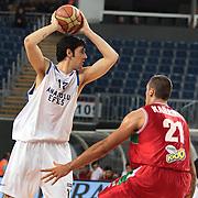 Anadolu Efes's Kerem Gonlum (L) during their Turkish Basketball League Play Off match Anadolu Efes between Pinar Karsiyakaat Sinan Erdem Arena in Istanbul, Turkey, Sunday, May 06, 2012. Photo by TURKPIX