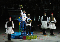 29/08/04 - Olympics Games Athens 2004 - MEN MARATHON CORONATION at the Olympic stadium - <br />Gold Medal - Italian STEFANO BALDINI <br />Silver Medal - USA  Mebrahton KEFLEZIGHI<br />Bronce Medal - Brazil Vanderlei de LIMA<br />© Gabriel Piko / Argenpress.com / Piko-Press