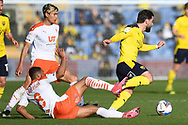 Blackpool forward Keshi Anderson (8) comes in to tackle Oxford United midfielder (on loan from Luton Town) Elliott Lee (27) during the EFL Sky Bet League 1 play off 1st leg match between Oxford United and Blackpool at the Kassam Stadium, Oxford, England on 18 May 2021.
