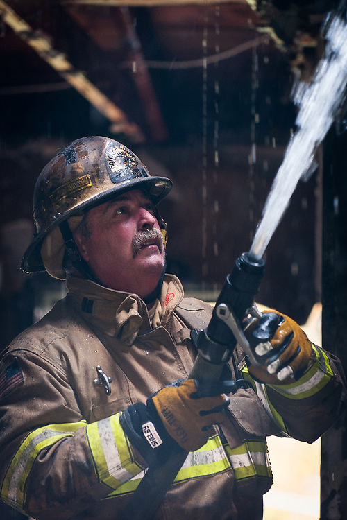 Firefighters train while doing a controlled burn of a residential home in Fairfax County Virginia.