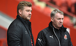 Charlton Athletic manager Karl Robinson (left) and Fleetwood Town manager John Sheridan