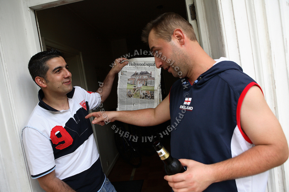 Nego, 31, from Romania, is being teased by a friend for having appeared in the local press with the other squatters in regards to their peculiar way of choosing residences to squat, on Saturday, July 14, 2007, in front pf their new mansion in Wildwood Road, Hampstead, London, England. Situated opposite Hampstead Heath, North London's green jewel, the average price for properties on this road reaches £ 2,500,000. Million Dollar Squatters is a documentary project in the lives of a peculiar group of squatters residing in three multi-million mansions in one of the classiest residential neighbourhoods of London, Hampstead Garden. The squatters' enthusiasm, their constant efforts to look after what has become their home, their ingenuity and adventurous spirit have all inspired me throughout the days and nights spent at their side. Between the fantasy world of exclusive Britain and the reality of squatting in London, I have been a witness to their unique story. While more than 100.000 properties in London still lay empty to this day, squatting provides a valid, and lawful alternative to paying Europe's most expensive rent prices, as well as offering the challenge of an adventurous lifestyle in the capital.