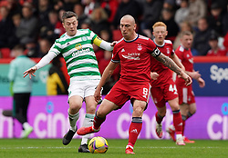 Celtic's Callum McGregor (left) and Aberdeen's Scott Brown battle for the ball during the cinch Premiership match at Pittodrie Stadium, Aberdeen. Picture date: Sunday October 3, 2021.