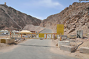 Border ahead warning sign while the road closed by a barrier. Photographed Near Eilat, Israel