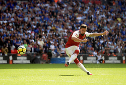 Arsenal's Olivier Giroud scores the deciding penalty during the shoot out in the Community Shield at Wembley, London.