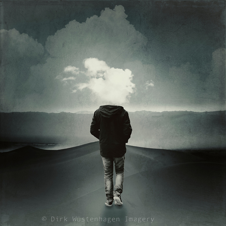Man walking with his head in the clouds - surreal photo manipulation