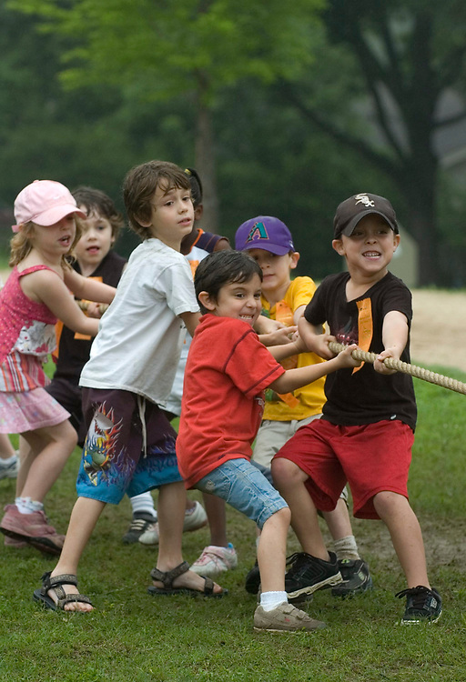 Austin, TX May 8, 2007:  Kindergarten children in teams at a rope pull event (tug-of-war is not PC) for Barton Hills Elementary 'outdoor olympics' to wrap up the school year.   ©Bob Daemmrich /