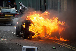 © Licensed to London News Pictures . 08/08/2011 . London , UK . A car is set alight in Hackney on a 3rd night of rioting and looting in London , which followed a protest against the police shooting of Mark Duggan in Tottenham . Photo credit : Joel Goodman/LNP