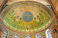 Apse Mosaics with a simple Orthodox crucifix and a depiction of St. Apollinare. 6th century AD Byzantine Roman Mosaics of the Basilica of Sant'Apollinare in Classe, Ravenna Italy. A UNESCO World Heritage Site. .<br /> <br /> Visit our BYZANTINE MOSAIC PHOTO COLLECTION for more   photos  to download or buy as prints https://funkystock.photoshelter.com/gallery/Byzantine-Eastern-Roman-Style-Mosaics-Pictures-Images/G0000NvKCna.AoH4/3/C0000YpKXiAHnG2k<br /> <br /> If you prefer to buy from our ALAMY PHOTO LIBRARY  Collection visit : https://www.alamy.com/portfolio/paul-williams-funkystock/san-apollinaire-classe-ravenna.html