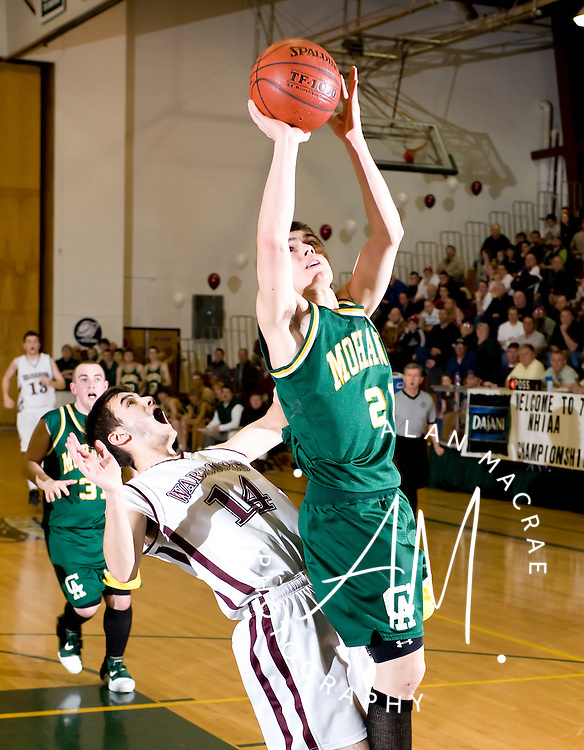 Colebrook's Ryan Call is fouled by W-L's Zach Rolke during Saturday's NHIAA Class S Championship game at PSU.  (Alan MacRae/for the Union Leader)