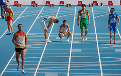 Gregor Kokalovic (3L) as fourth and Bostjan Fridrih as third Slovenia sprinter felt during  the 4x100m Mens Relay Heats during day five of the 20th European Athletics Championships at the Olympic Stadium on July 31, 2010 in Barcelona, Spain.  (Photo by Vid Ponikvar / Sportida)