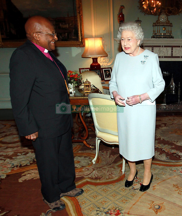 Reverend Desmond Tutu during an audience with Queen Elizabeth II at Buckingham Palace, central London.