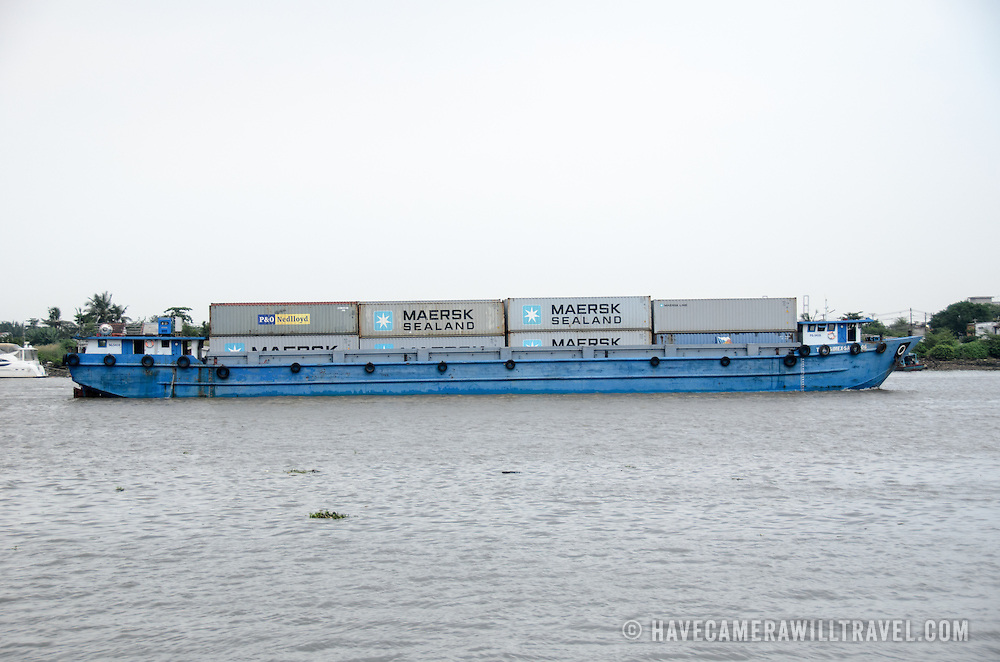 A small container ship on the Saigon River in Ho Chi Minh City, Vietnam.