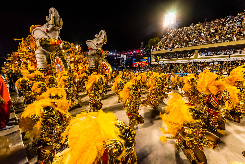 """Performers on floats in the Carnaval parade of Academicos do Salgueiro samba school in the Sambadrome, Rio de Janeiro, Brazil.               The theme of their parade is """"The Black King of the Riding Arena"""". It is a tribute to Benjamin de Oliveira, the first black clown in Brazil."""
