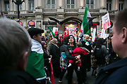 Thousands of people turned out in Central London to protest against the ongoing bombardment of Aleppo, December 17th 2016 in London, Unted Kingdom. The route went down Oxford Street and Regents Street full of Christmas decorations and shoppers. A very upset mother berates shoppers and onlookers for caring more about shopping than boms dropping on Aleppo.