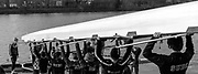 Hammersmith. London. United Kingdom,  crew carry the eight to the pontoon 2018 Men's Head of the River Race.  Championship Course, Putney to Mortlake. River Thames, <br /> <br /> Sunday   11/03/2018<br /> <br /> [Mandatory Credit:Peter SPURRIER Intersport Images]<br /> <br /> Leica Camera AG  M9 Digital Camera  1/1500 sec. 50 mm f. 160 ISO.  17.5MB