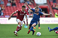 Jamie Paterson (20) of Bristol City is challenged by Sebastian Larsson (16) of Hull City during the EFL Sky Bet Championship match between Bristol City and Hull City at Ashton Gate, Bristol, England on 21 April 2018. Picture by Graham Hunt.