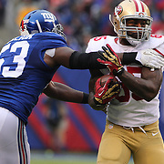 Vernon Davis, San Francisco 49ers, is tackled by Jameel McClain, New York Giants, during the New York Giants V San Francisco 49ers, NFL American Football match at MetLife Stadium, East Rutherford, NJ, USA. 16th November 2014. Photo Tim Clayton