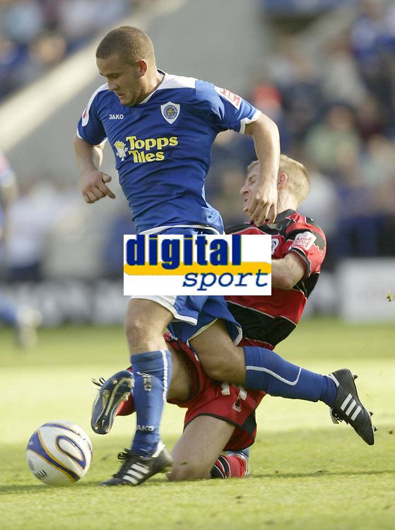 Photo: Aidan Ellis.<br /> Leicester City v Queens Park Rangers. Coca Cola Championship. 15/09/2007.<br /> QPR's Martin Rowlands tackles Leicester's James Wesolowski