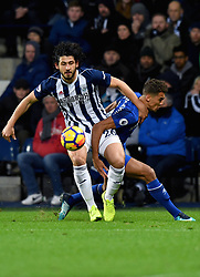 West Bromwich Albion's Ahmed Hegazy (left) and Everton's Dominic Calvert-Lewin compete for possession