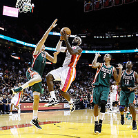 22 January 2012: Miami Heat small forward LeBron James (6) goes for the layup against Milwaukee Bucks power forward Ersan Ilyasova (7) during the Milwaukee Bucks 91-82 victory over the Miami Heat at the AmericanAirlines Arena, Miami, Florida, USA.