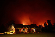 The Twisp River Fire lights up the sky near the Community Covenant Church in Twisp early in the morning Thursday, Aug. 20, 2015.  <br /> <br /> Erika Schultz / The Seattle Times