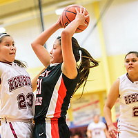 022315  Adron Gardner/Independent<br /> <br /> Rehoboth Lynx Leahrae Francisco (23), left, guards Crownpoint Eagle Tamika Shorty (21) as Lynx Amada Martin (21) looks on in Rehoboth Monday.