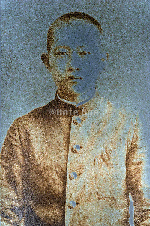 extreme silver mirroring on a vintage portrait of a young adult boy wearing a school uniform Japan