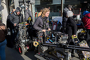 A Film industry crew remove camera and sound equipment from a location among members of the public in Kingston town centre, after filming outside in the street, on 13th November 2019, in London, England.