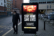 HM Government, and NHS advertising boards advice to stay at home and help save lives during the third national coronavirus lockdown in Birmingham city centre, which is deserted apart from a few people on 7th January 2021 in Birmingham, United Kingdom. Following the recent surge in cases including the new variant of Covid-19, this nationwide lockdown, which is an effective Tier Five, came into operation yesterday, with all citizens to follow the message to stay at home, protect the NHS and save lives.