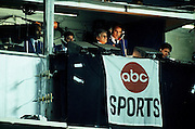 The ABC Sports Monday Night Football television crew, including O.J. Simpson (far left) and Frank Gifford (second from right), broadcasts the Washington Redskins NFL football game against the St. Louis Cardinals on October 7, 1985 in Washington, DC. The Redskins won the game 27-10. ©Paul Anthony Spinelli