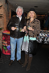 HUGH HUDSON and MARYAM D'ABO at a Mexican Feast cooked by Thomasina Miers in aid of the charity Too Many Women held at Wahaca Soho, 80 Wardour Street, London on 9th November 2011.