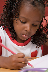 Portrait of young girl drawing,
