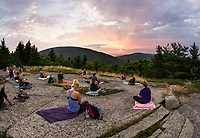 Sunrise yoga class from the top of Piper Mountain.  (Karen Bobotas Photographer)