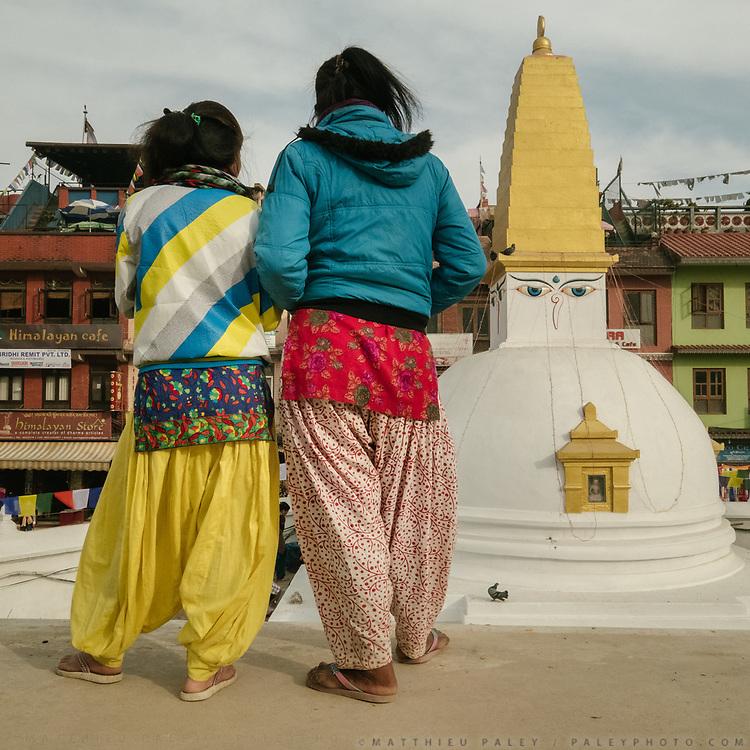 Walk around holy shrine known as Boudhanath.