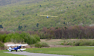 Wurtsboro, NY - A glider comes in for a landing as a 1941 Waco biplane waits to take off during  the grand reopening of Wurtsboro Airport on May 11, 2008.