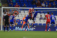 Shane Duffy of Blackburn Rovers © gets the last touch to score an own goal, his 2nd, for Cardiff's 2nd goal.  EFL Skybet championship match, Cardiff city v Blackburn Rovers at the Cardiff city stadium in Cardiff, South Wales on Wednesday 17th August 2016.<br /> pic by Andrew Orchard, Andrew Orchard sports photography.