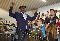 October 2, 2018 - Kiev, Ukraine - Former Boxing Champion LENNOX LEWIS greets supporters as he arrives an authographs session for supporters at the 56th World Boxing Convention in Kiev, Ukraine, on 2 October 2018.The WBC 56th congress in which take part boxing legends Evander Holyfield,Lennox Lewis, Eric Morales and about 700 participants from 160 countries runs in Kiev from from September 30 to October 5. (Credit Image: © Serg Glovny/ZUMA Wire)