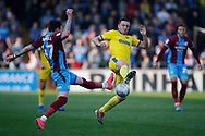 Scunthorpe United midfielder Adam Hammill (47) and Wimbledon midfielder Anthony Hartigan (8) contest a loose ball  during the EFL Sky Bet League 1 match between Scunthorpe United and AFC Wimbledon at Glanford Park, Scunthorpe, England on 30 March 2019.