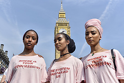 June 21, 2017 - London, UK - London, UK. Protesters stage a demonstration in Parliament Square after the Queen's Speech on a so called ''Day of Rage''.   Many were demanding justice for the victims of the Grenfell Tower fire whilst others were supporting Jeremy Corbyn and the Labour party. (Credit Image: © Stephen Chung/London News Pictures via ZUMA Wire)