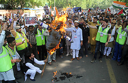 June 23, 2017 - New Delhi, India - Shia Muslims protest & burn effigy Prime Minister of Israel Benjamin Netanyahu against the oppression of Israel on Palestine to demand of delivering Baitul Muqaddas from the clutches of Israel and terrorism during international Quds Day at Jantar Mantar. (Credit Image: © Wasim Sarvar/Pacific Press via ZUMA Wire)