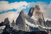 """Cerro Fitz Roy (3405 m or 11,171 ft elevation), seen from Ruta 23 near El Chalten mountain resort, in Los Glaciares National Park, Santa Cruz Province, Argentina, Patagonia, South America. Chaltén comes from a Tehuelche word meaning """"smoking mountain"""", due to clouds that usually form over Monte Fitz Roy."""